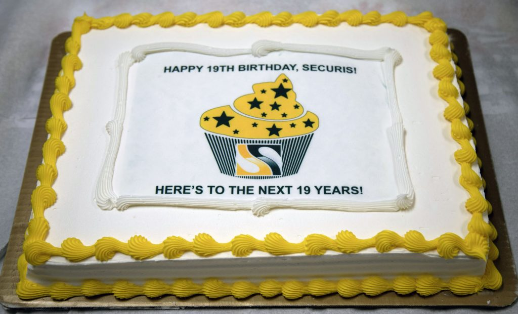 Celebrating 19 years of business with cake