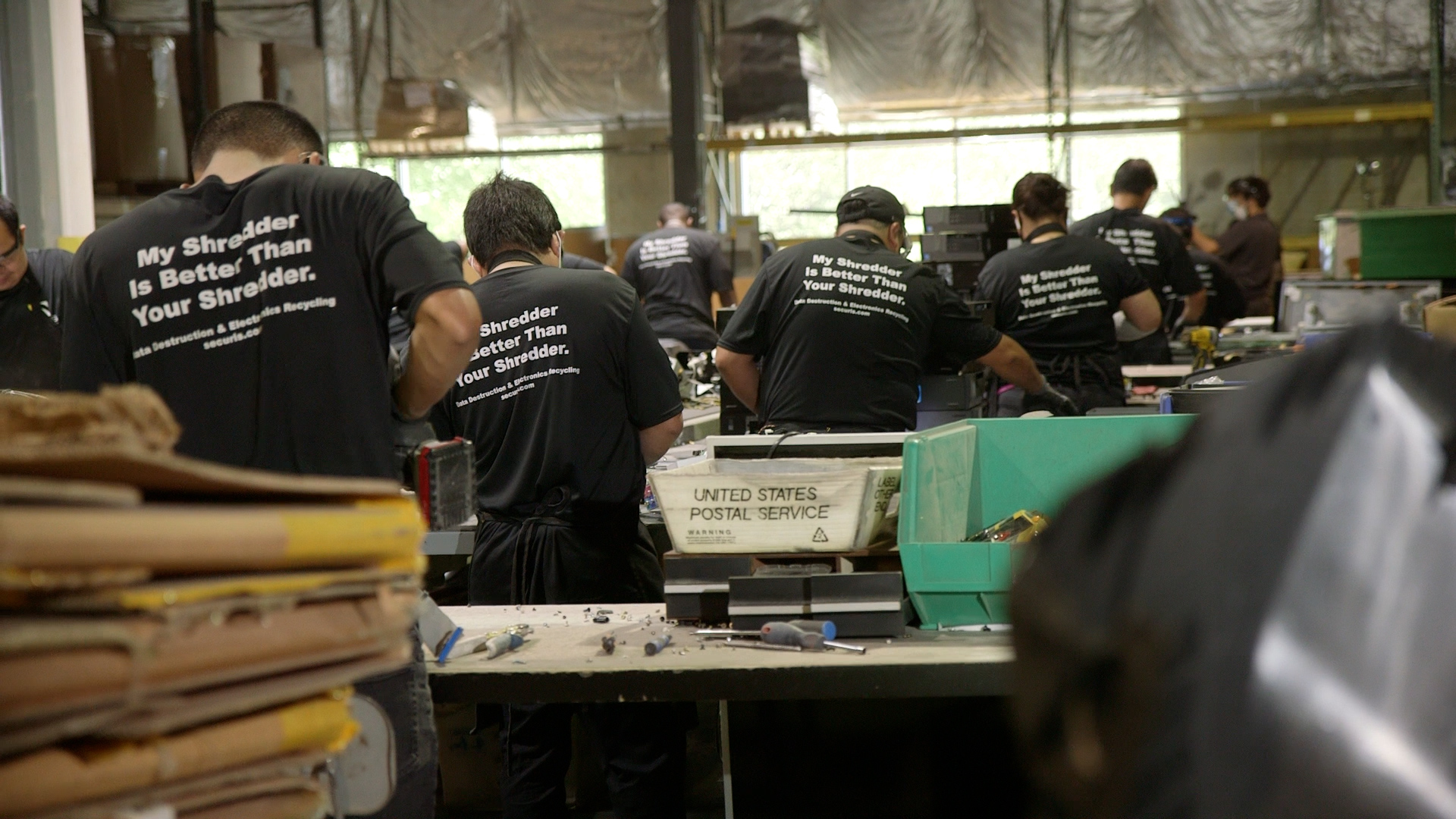 Warehouse workers in shredder shirts